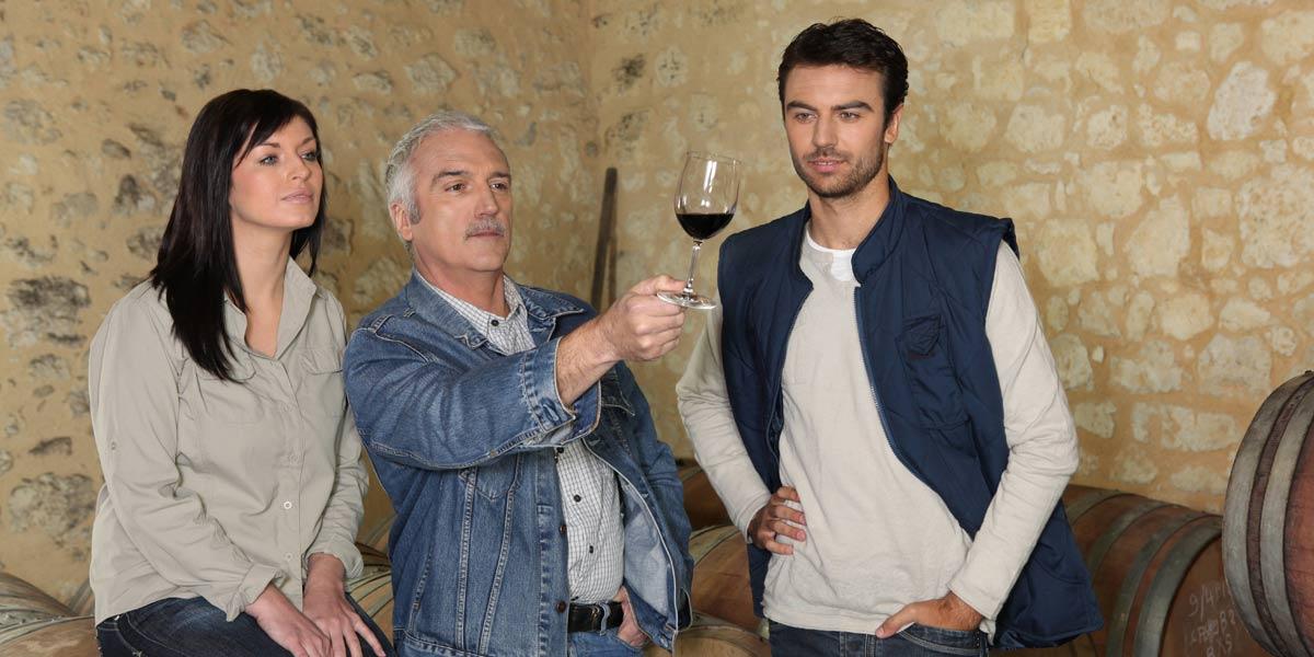 Couple going through winery tour, talking to their sommelier