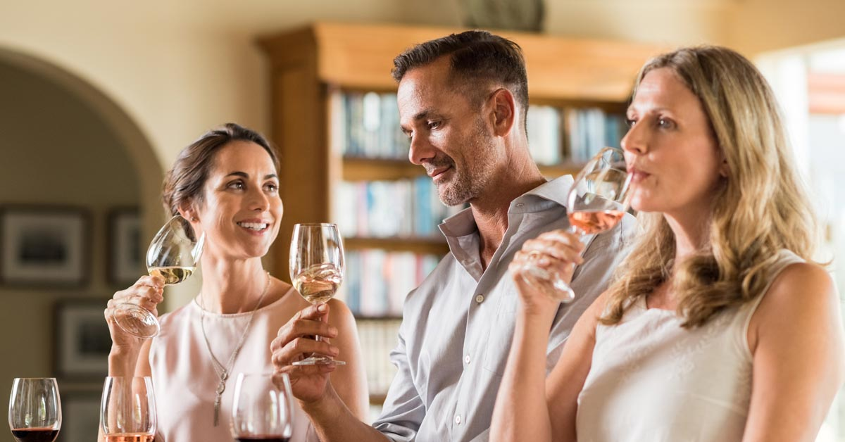 Group of friends sampling wine in a tasting room