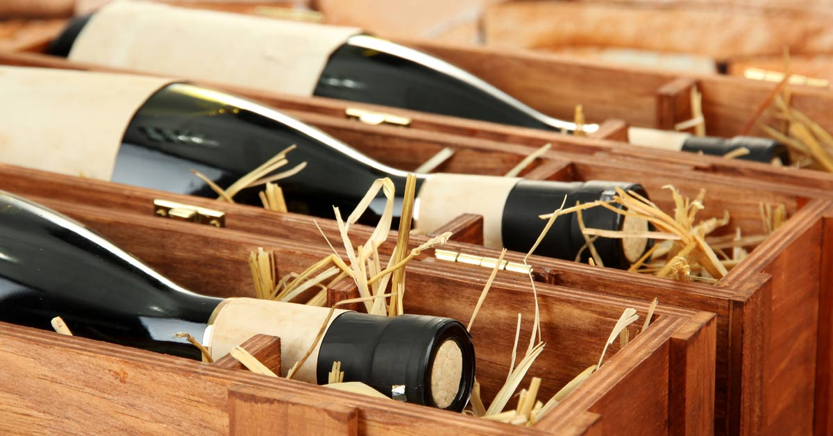 Bottles of wine down on their sides, in wooden casing